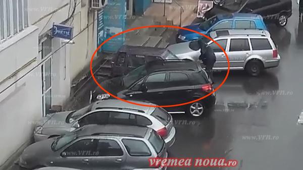 INEDIT! Si-a spãlat masina pe o ploaie torentialã (video)